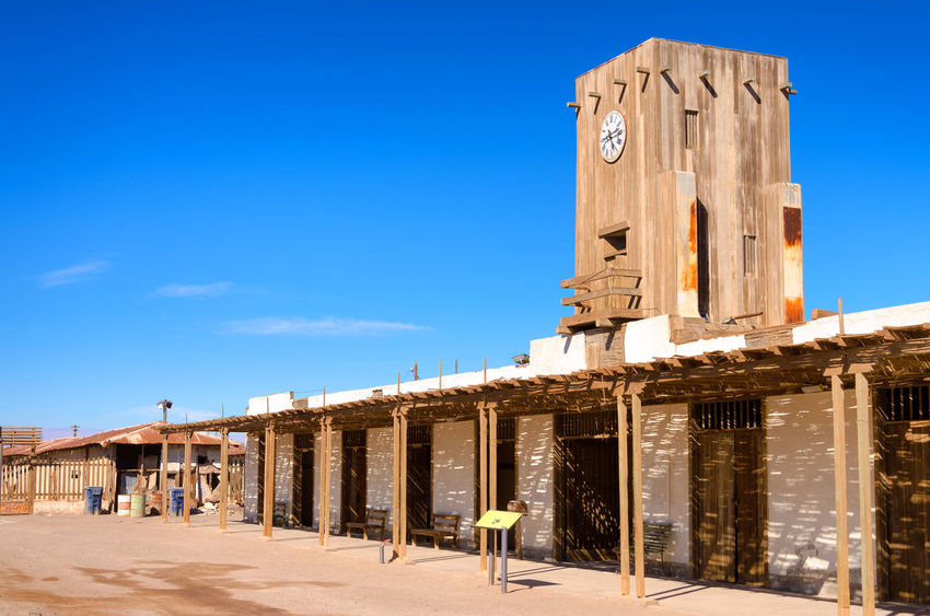 Town square of the abandoned ghost town of Humberstone, Chile America Architecture Atacama Building Chile Derelict Desert Heritage Historic Houses Humberstone Industrial Industry Iquique Landscape Museum Nitrate Old Ruins Saltpeter Saltpetre South Town UNESCO World Heritage Site Work