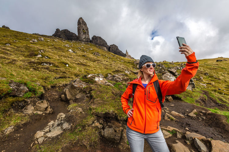 Woman Taking Selfie While Standing On Mountain