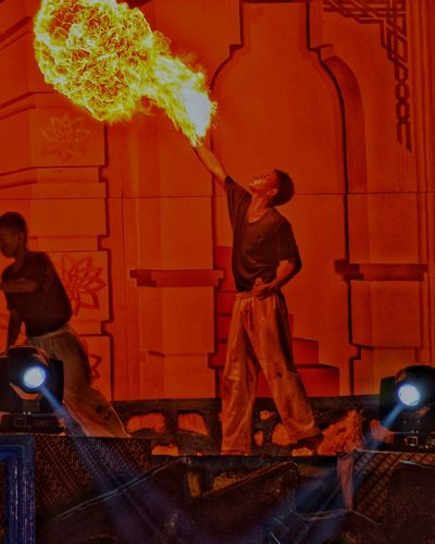 Blowing Fire Fire Man Orange Color Yellow Red My Best Photo Extreme Sports Extreme Hot Standing Friendship Astrology Sign Togetherness Stage Light Friend Entertainment Firework - Man Made Object The Art Of Street Photography