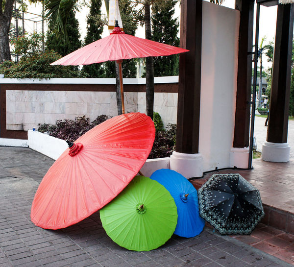 Umbrella on wet footpath