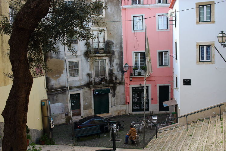 Cafe Streets Of Lisbon EyeEm City Lover Lissabon, Portugal Lisboa Portugal Lisbon - Portugal Building Exterior Built Structure Tree Architecture Plant Building Residential District Day City Window Nature Street Table Outdoors Transportation Tree Trunk House