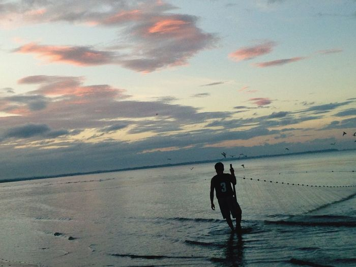Sea Real People Beach Sky Nature Water Leisure Activity Silhouette Lifestyles Beauty In Nature