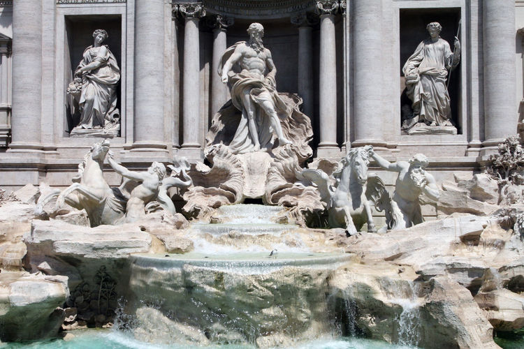 Trevi Fountain Architectural Column Architecture Art And Craft Building Exterior Built Structure Craft Creativity Day Female Likeness Flowing Flowing Water Fountain Government History Human Representation Male Likeness No People Representation Sculpture Statue Stone Material The Past Water