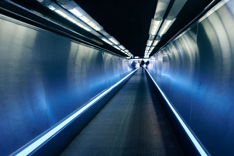 Interior Of Illuminated Subway Moving Walkway