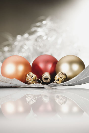 Close-Up Of Christmas Baubles On Table