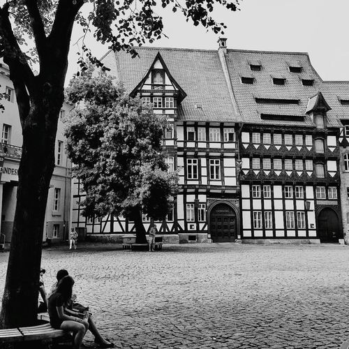 In conversation Medieval Architecture Cobbled Pavement Tree Timber Framed House Couple Black And White Brunswick Braunschweig