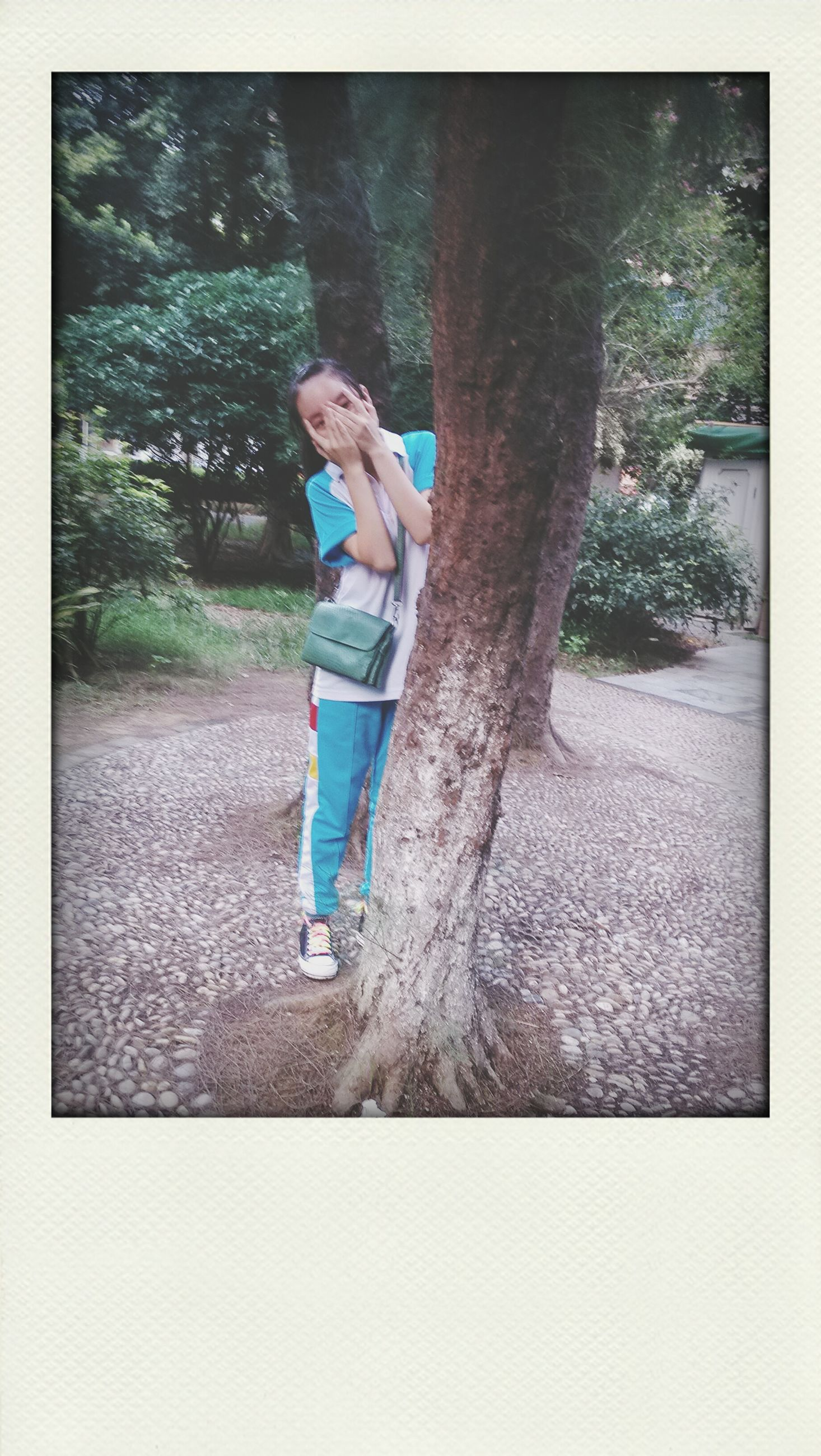 lifestyles, transfer print, full length, leisure activity, casual clothing, person, young adult, auto post production filter, front view, standing, childhood, young women, tree, fun, holding, elementary age, looking at camera, enjoyment
