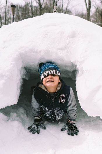 Looking At Camera Winter Portrait One Person Snow Warm Clothing Childhood Cold Temperature Real People Children Only Front View Child Knit Hat Innocence Waist Up Smiling Elementary Age Happiness Outdoors Cap