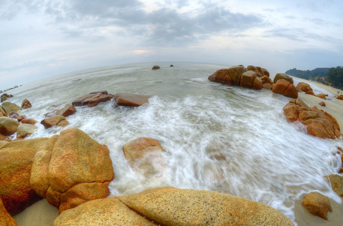 thru fish eye lens Fish Eye Sea Water Beach Rock - Object No People Nature Cloud - Sky Landscape Outdoors Wave Day Beauty In Nature Sky