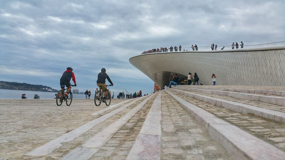 the new museum of Art,Architecture and Technology Belém Bicycles Bikers Cloud Group Of People Large Group Of People Leading Lines Maat Museum Outdoors Sea Sky Tourist Weekend Activities Lisbonlovers Portugal_lovers Portugal_em_fotos Architecture Architectural Feature Modern Architecture City Life CyclingUnites Cycling Incidental People