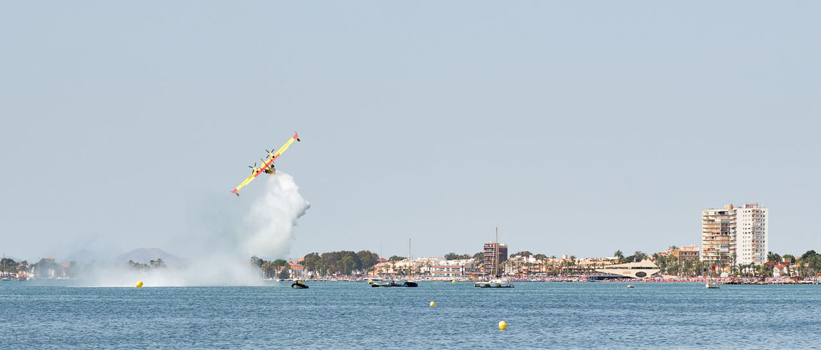 San Javier, Spain - June 10, 2018: San Javier Air Show. It is one of the most visually impressive events in the Murcia. Aerobatic teams accompanied by helicopter and parachute display teams 2018 Air Force Mediterranean Sea Murcia SPAIN San Javier Spanish Spectators Action Air Show Aircraft Airplane Beach Editorial  Entertainment Jet Leisure Activity Military Airplane Nature Outdoors People Real People Sea Sky Summer