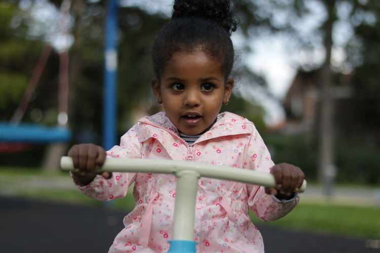 Cute girl playing on seesaw