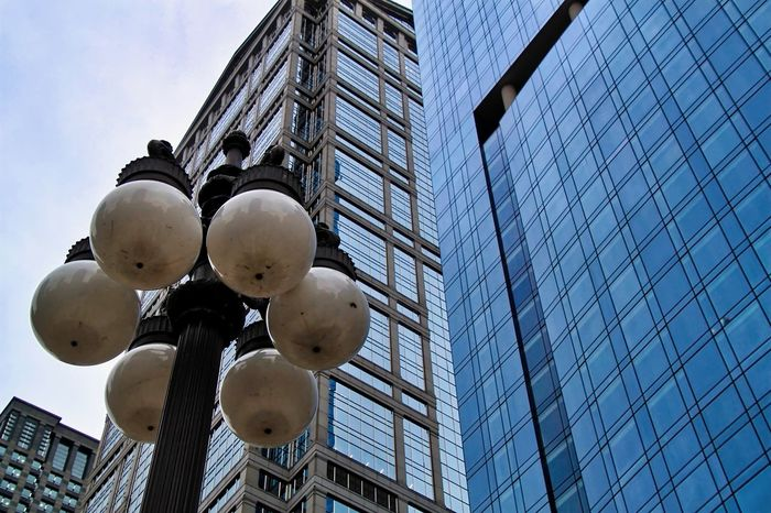Round Chicago Chicago Loop City Cityscape Downtown Chicago Lightbulbs Architecture Blue Building Exterior Buildings & Sky Built Structure City Day Globes Gloomy Day Lightpost Low Angle View Mirrored Reflection Modern No People Outdoors Sky Skyscraper Street Globe shaped lightbulb fixture on Wacker Drive, Chicago look like eyeballs.