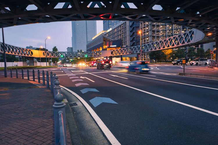 Traffic on bridge in city at night