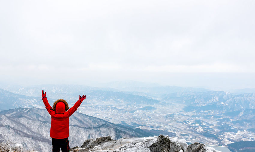 Winter Snow Mountain in South Korea Mountain Human Arm Arms Raised One Person Mountain Range Standing Adventure Red Looking At View Freedom Human Limb Landscape Adult Scenics - Nature Nature Body Part Beauty In Nature Korea Seoul Seoul, Korea