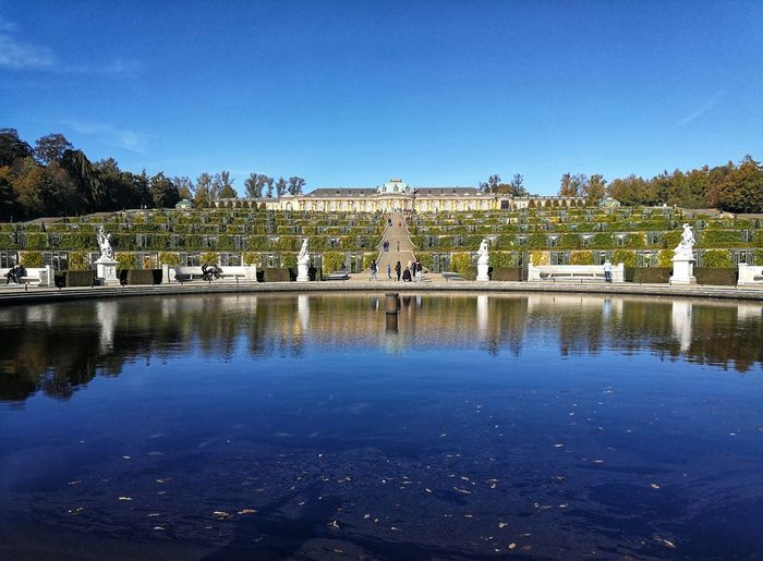 Sanssouci Palace and the vineyard terrace Berlin Fountain Tourism Tourist Attraction  Tourist Destination Huawei Photography Huaweip10plus Snapseed Sanssouci Park Potsdam Vineyard Vineyard Terraces Potsdam Terrace Palace Water Clear Sky Blue Lake Tree Reflection Sky Landscape Royalty Royal Person Castle