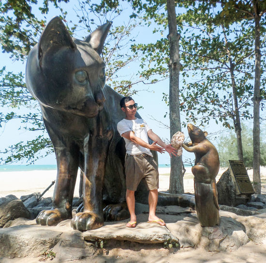 Statue Leisure Activity Lifestyles Men And Cars One Person Real People Standing Young Adult