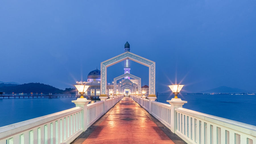 Illuminated bridge over sea