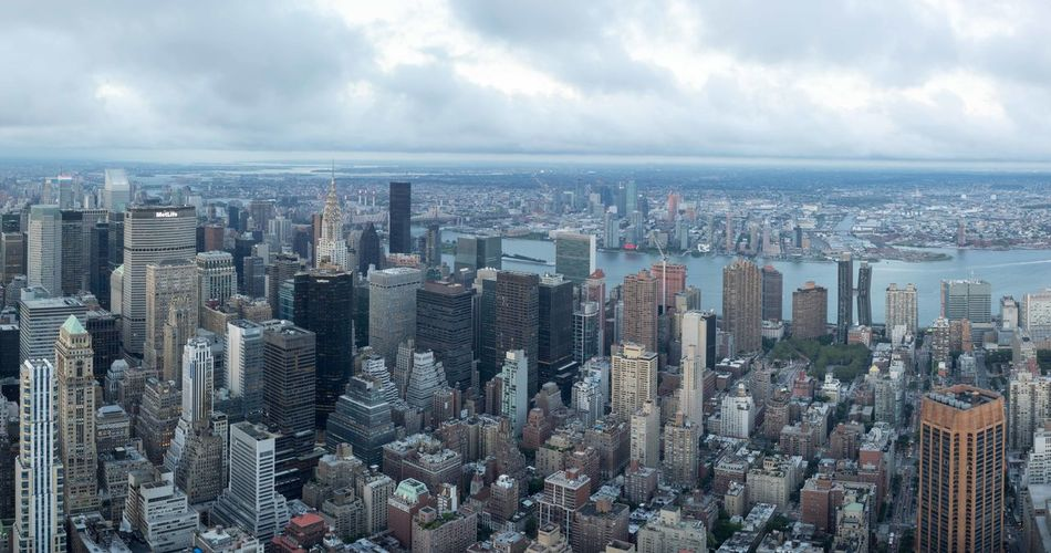 Aerial View Architecture Building Exterior City Cityscape Cloud - Sky Crowded Day Development Downtown District High Angle View Modern Outdoors People Sea Sky Skyscraper Storm Cloud Travel Destinations Urban Skyline Water
