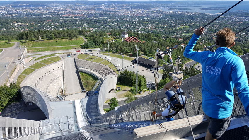 Holmenkollbakken is a large ski jumping hill located at Holmenkollen in Oslo, Norway. It has a hill size of HS134, a construction point of K-120, and a capacity for 70,000 spectators. Holmenkollen has hosted the Holmenkollen Ski Festival since 1892, which since 1980 have been part of the FIS Ski Jumping World Cup and 1983 the FIS Nordic Combined World Cup. It has also hosted the 1952 Winter Olympics and the FIS Nordic World Ski Championships in 1930, 1966, 1982 and 2011. The hill has been rebuilt 19 times; important upgrades include a stone take-off in 1910, an in-run superstructure in 1914, and a new superstructure in 1928. During the Second World War, the venue was used as a military installation, but upgraded in the late 1940s. Further expansions were made ahead of the 1966 and 1982 World Championships, as well as in 1991. Between 2008 and 2010, the entire structure was demolished and rebuilt. As of 8 February 2011, the hill record is unofficially held by Anders Jacobsen at 142.5 meters. The official hill record was set at 5 March 2011 by Andreas Kofler at 141 meters. The hill is part of Holmenkollen National Arena, which in addition to cross-country and biathlon venues has the normal hill Midtstubakken. Adrenaline Junkie Getting Inspired Hill Holmenkollbakken Holmenkollen Olympic Olympicgames Olympics Ski Ski Jump Ski Jumping Ski Jumping Hill Ski Jumps Skiing Skijump Skijumping Speed Sport Sports Sports Photography The Purist (no Edit, No Filter) Winter Olympics Zip Line Zipline Ziplining