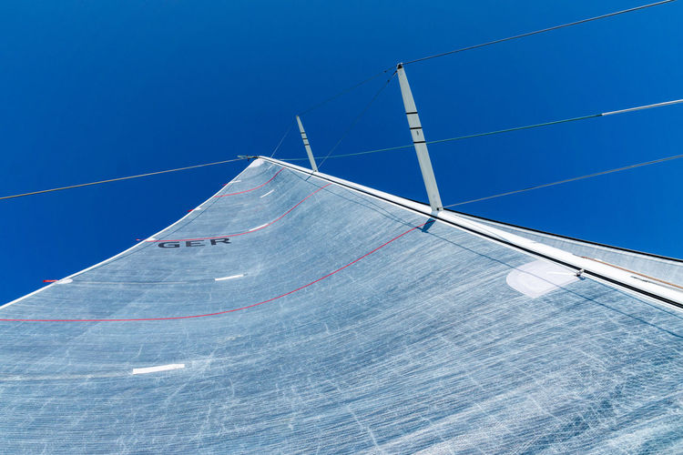 sail of a sailing boat - blue sky Blue Sky Low Angle View Clear Sky No People Day Built Structure Architecture Copy Space Outdoors Shape Sport Sunlight Nautical Vessel Geometric Shape Sailboat Sailing