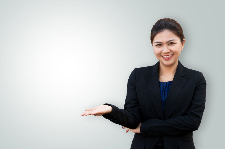 Asian business woman showing something on hand palm Asian  Beautiful Copy Space Happy Isolated Looking At Camera Palm Surprised Thai Woman Advertisement Arms Raised Background Business Businesspeople Businesswoman Color Hand Person Portrait Secretary Smiling Studio Shot Successful Suit