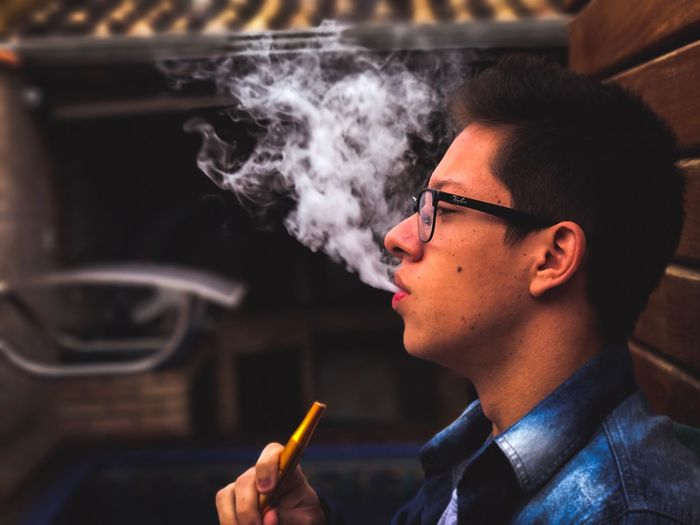 Smoking - Activity Addiction Cigarette  Smoke - Physical Structure Smoking Issues Bad Habit Young Adult Only Men Social Issues Men Marijuana - Herbal Cannabis Headshot Tobacco Product One Person Indoors  One Man Only Adult People Adults Only Close-up Smoker Hookah Time  Hookah Smoke Smoking