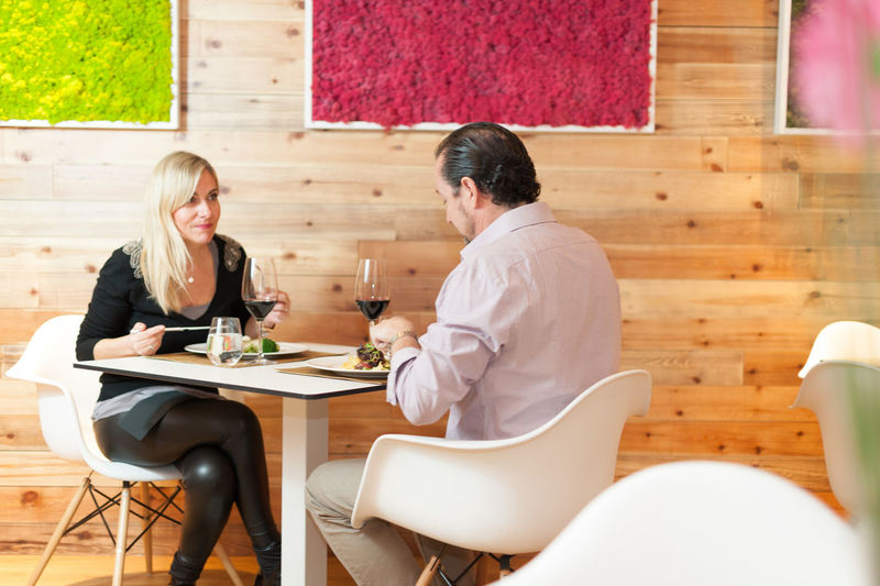 Mature couple having food and drink at restaurant