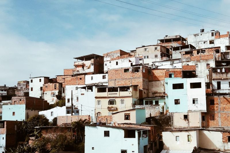 Houses in city against sky