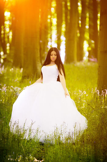 Beautiful Woman Bride Cheerful Day Forest Front View Full Length Grass Happiness Leisure Activity Life Events Looking At Camera Nature One Person Outdoors Portrait Real People Smiling Standing Tree Wedding Wedding Dress Women Young Adult Young Women