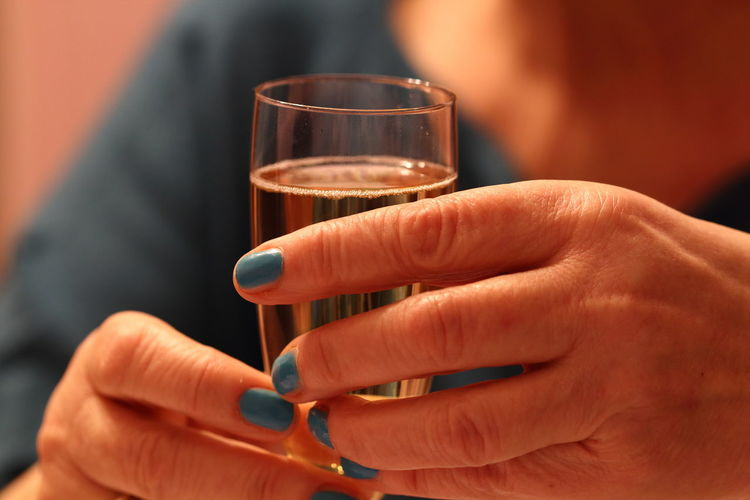 Cropped Image Of Woman Holding Wine