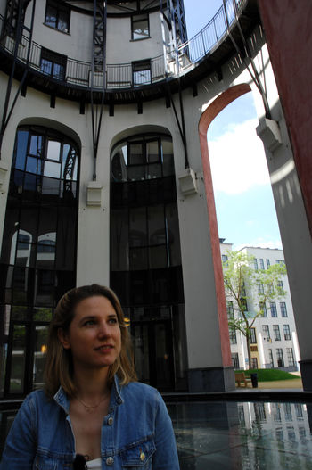 Architecture Built Structure Building Exterior Real People Window Portrait Young Adult Day One Person Lifestyles Front View Leisure Activity Looking At Camera Building Young Women City Women Casual Clothing Outdoors Contemplation Beautiful Woman Hairstyle