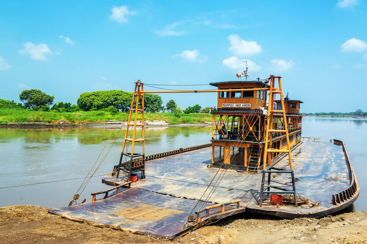 Old historic ferry waiting to take passenger along the Magdalena River to and from Mompox, Colombia Blue Boat Boats Cloud Colombia Day Ferry Ferryboat Historic Historical Magdalena Magdalena River Mompos Mompox  Nature Old Orange Orange Color Outdoors Rio Magdalena River Sky Water Watercraf