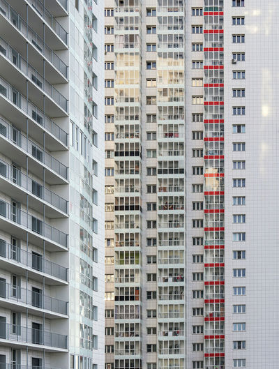A large number of windows and balconies on building facade. apartment block. residential building