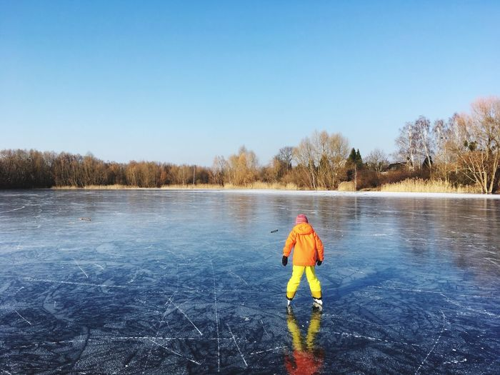 Winter Sport Winter One Person Cold Temperature Sport Full Length Adult Clear Sky Lake People Blue Sports Clothing Outdoors Ice-skating Snow