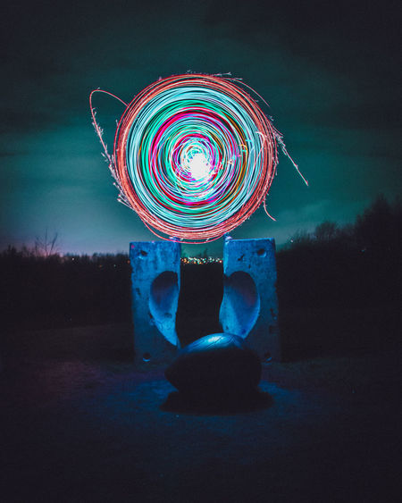 Spin City Night Multi Colored Illuminated No People Motion Nature Long Exposure Glowing Tree Blurred Motion Sky Art And Craft Decoration Field Geometric Shape Plant Creativity Shape Circle Light Painting Outdoors