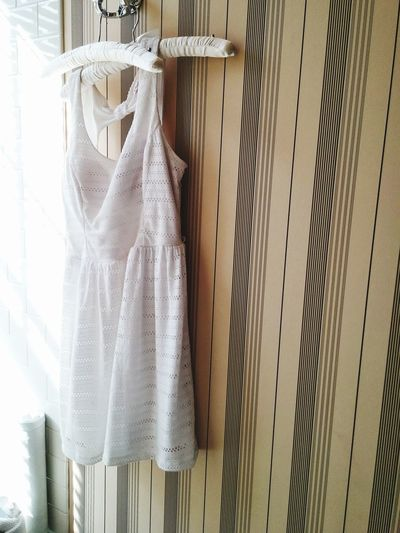 Close-up of dress hanging against wall at home