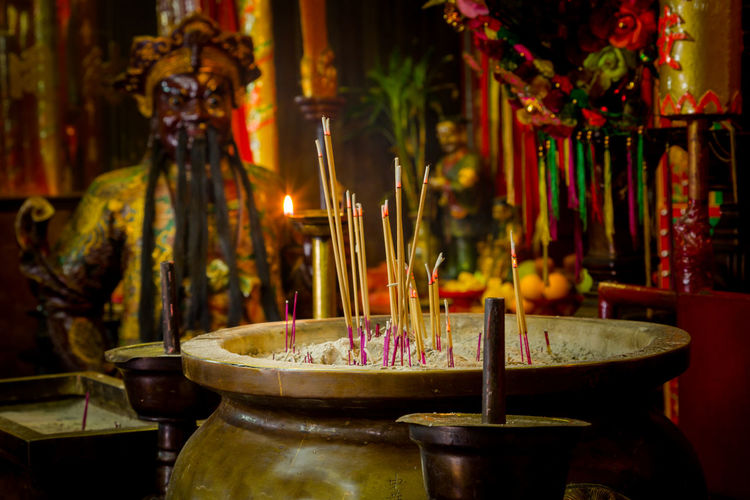 Image from Man Mo temple, Hong Kong Man Mo Temple Statue Altar Architecture Belief Buddism Buddist Temple Building Built Structure Burning Candle Candlestick Holder Fire Flame Incense Indoors  Joss Sticks Man Model No People Place Of Worship Religion Religious Equipment Shrine Spirituality Temple