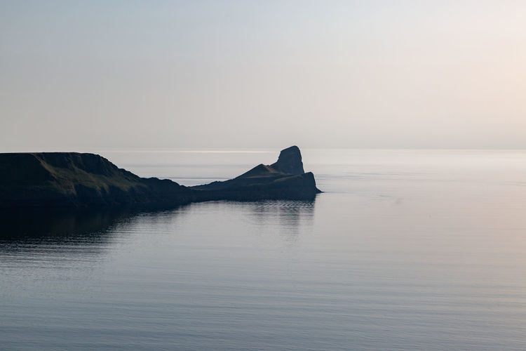Looking out over rhossili bay towards worm's head, just before sunset