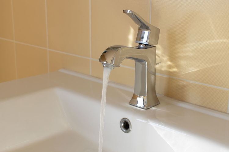 Faucet in bathroom at home