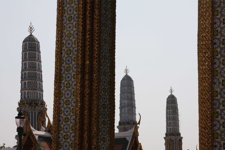 Low angle view of towers at wat phra kaew