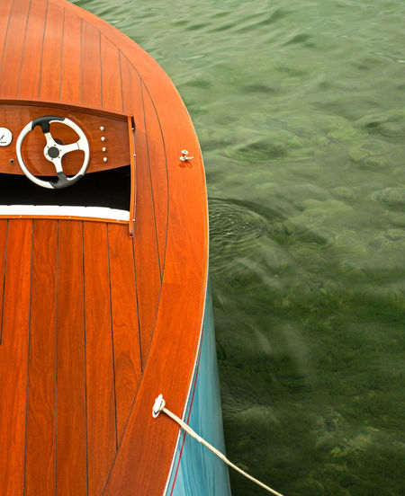 High Angle View Of Orange Boat Moored In Sea