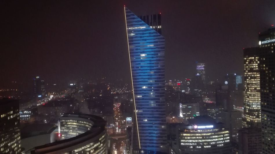 Warsaw skyline Night Illuminated Skyscraper Architecture City Building Exterior Cityscape Modern Built Structure Outdoors Urban Skyline