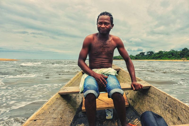 So relaxing to be on the sea Beach One Man Only Portrait Lifestyles Shirtless Sitting One Young Man Only Vacations Sport Water Life Journey EyeEm Best Shots - Nature Happiness Africa Travel Dynamic Africa Seaside Sea_collection Traveling Sea View Fishing Outdoors