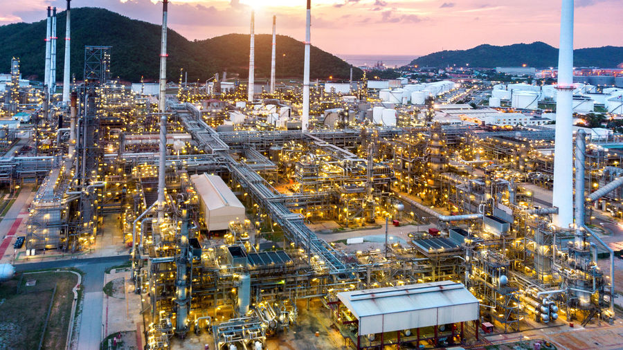 Aerial view of Oil refinery, Oil Industry at sunset. Architecture Building Exterior Built Structure Business City Cityscape Cloud - Sky Dusk Fuel And Power Generation High Angle View Illuminated Industry Nature Night No People Oil Industry Outdoors Sky Sunset Transportation