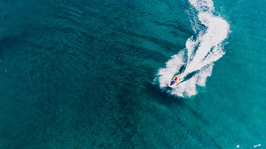 Aerial view of speedboat in sea