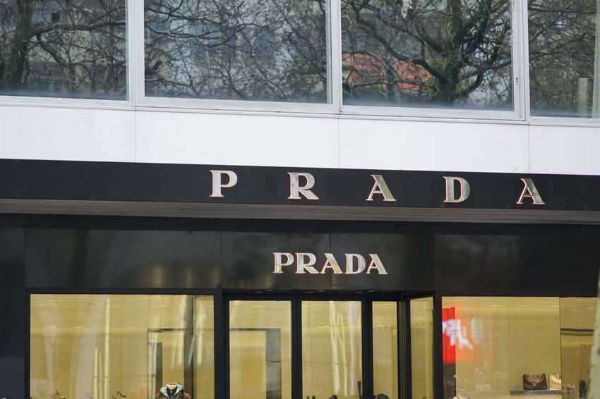 Brussels, Belgium - December 9, 2017: Prada store exterior. Prada S.p.A. is an Italian luxury fashion house specializing in leather handbags, travel accessories, shoes, ready-to-wear, perfumes Boutique Clothes Store Fashion Clothes Shop Clothing Shop Clothing Store Fashionable Prada Style Trendy