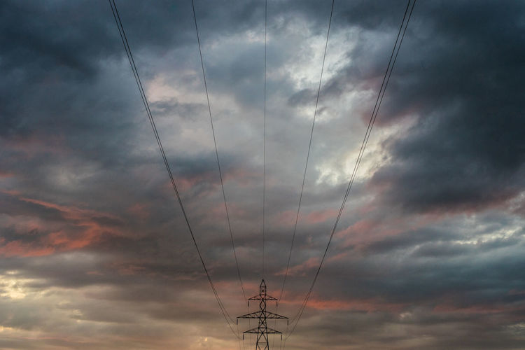 View of electricity pylon. dramatic sky. hochspannungsleitung im sonnenuntergang. nature power
