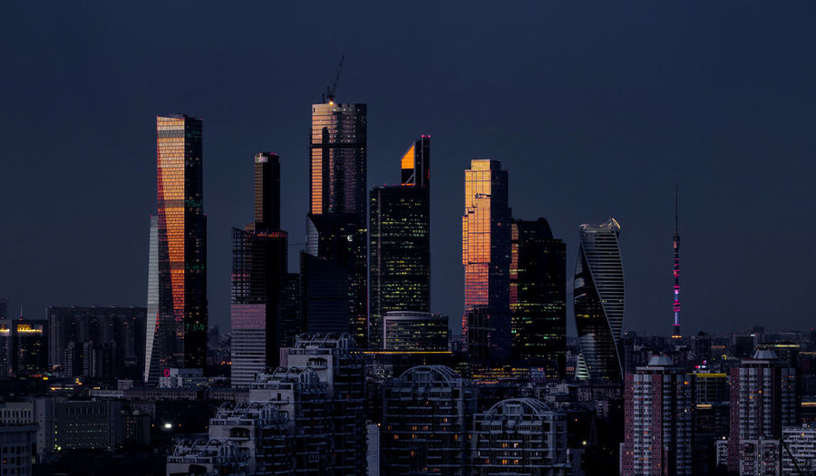 Russia, Moscow, Moscow city at sunset Architecture Building Exterior Built Structure Capital Cities  City City Life Cityscape Clear Sky Development Financial District  Illuminated Modern Night Office Building Skyline Skyscraper Tall Tall - High Tower Urban Skyline