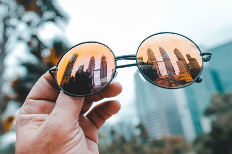KLCC Still Life Urban Life Architecture Lifestyles Glass - Material Personal Perspective Petronas Twin Towers Kuala Lumpur City Centre Klcc Sun Glasses Finger Close-up Focus On Foreground Holding Travel Holiday Destination Vacation Tourist Attraction  Iconic Landmark